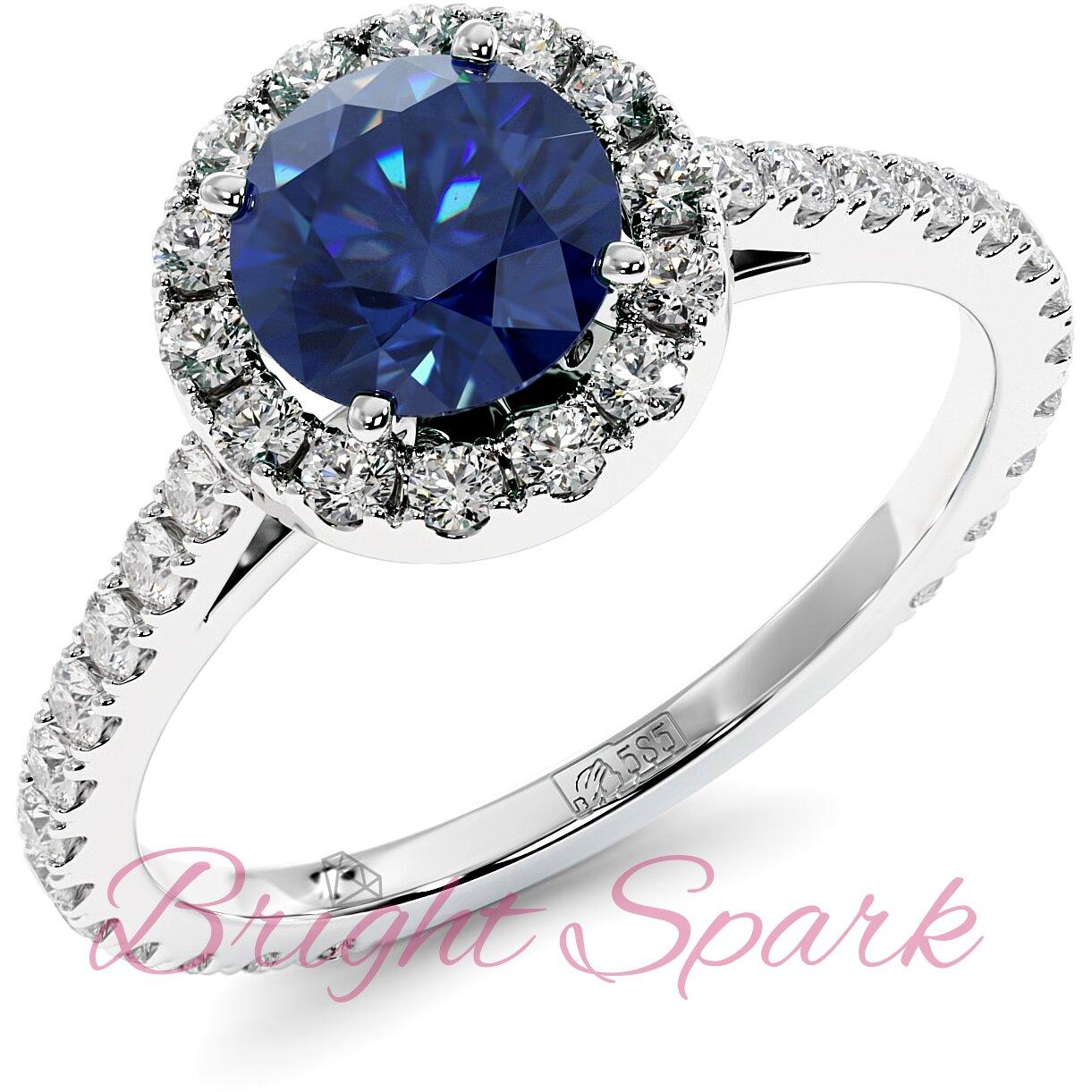 Помолвочное кольцо белого золота с синим сапфиром 1,2 карата, ореолом и дорожкой