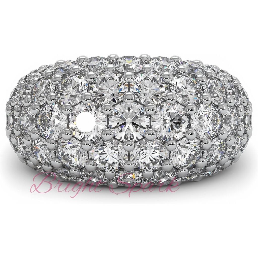 Широкое вечернее кольцо из белого золота с россыпью
