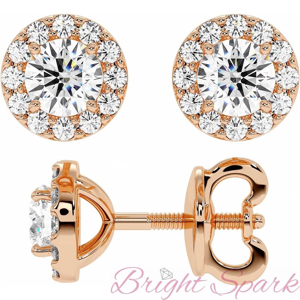 Пусеты розового золота с бриллиантом пол карата в обрамлении мелких бриллиантов