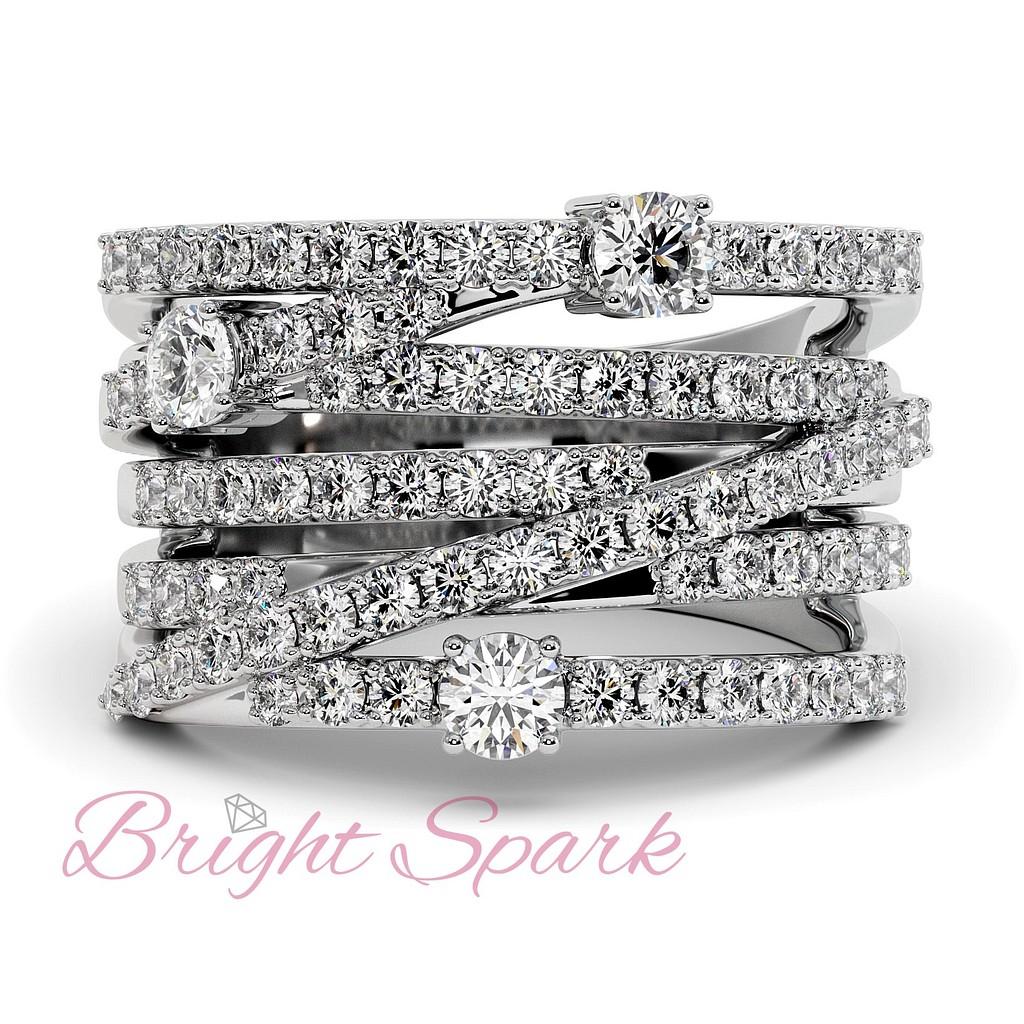 Вечернее кольцо с переплетением дорожек бриллиантов из белого золота