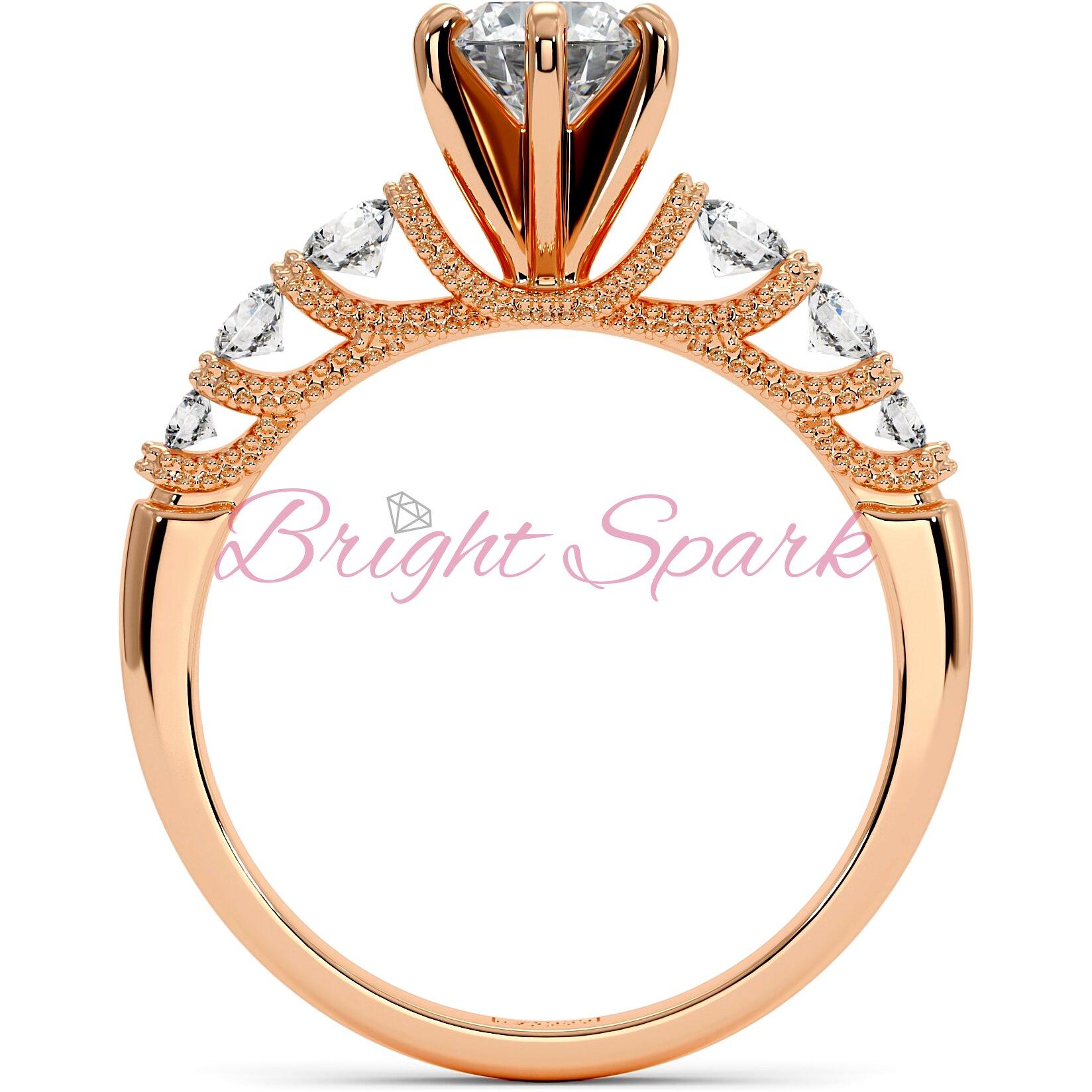 Кольцо с филигранью и боковыми камнями из розового золота