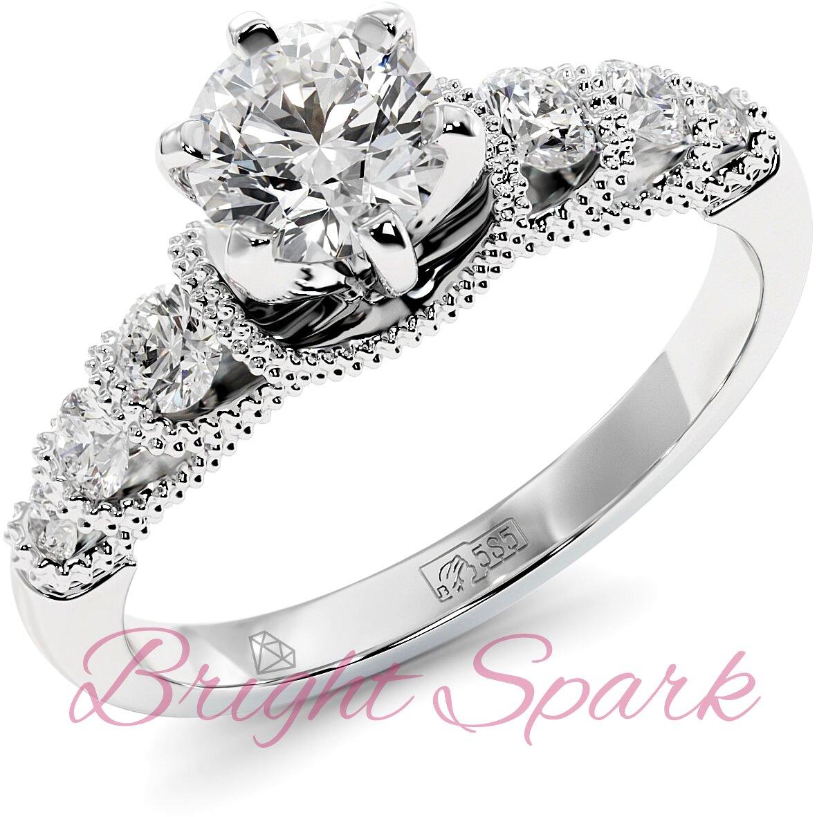 Помолвочное кольцо с филигранью и боковыми камнями из белого золота
