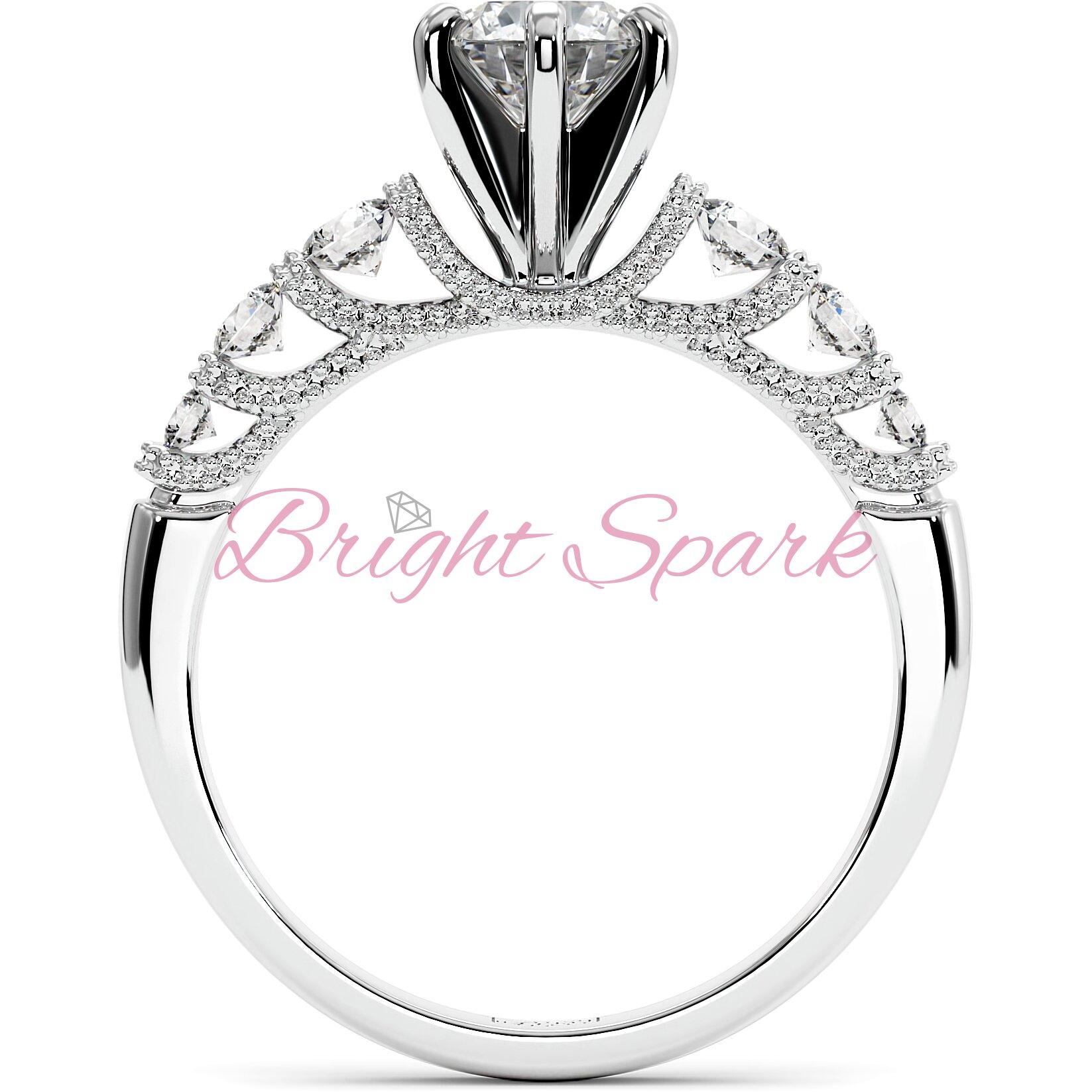 Кольцо с филигранью и боковыми камнями из белого золота