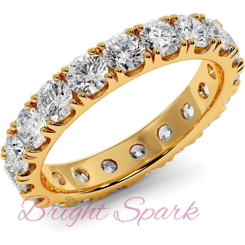 Кольцо желтого золота с камнями по кругу