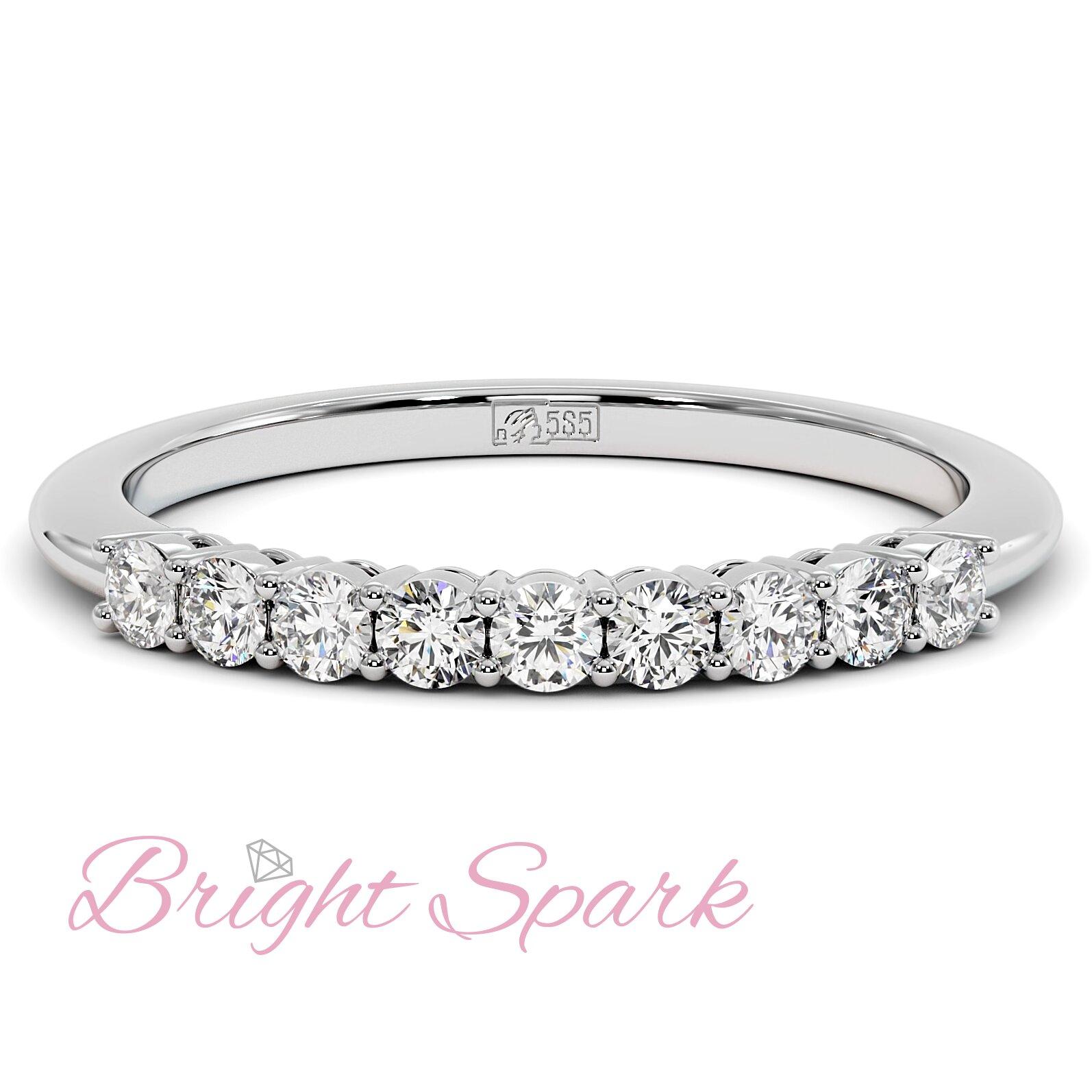 Кольцо белого золота с дорожкой из девяти камней Embrace на 0,3 карат