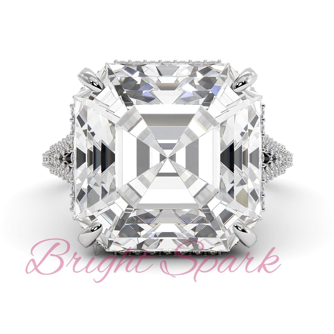 Кольцо белого золота с бриллиантом огранки ашер и россыпью Queen 14,2  карата