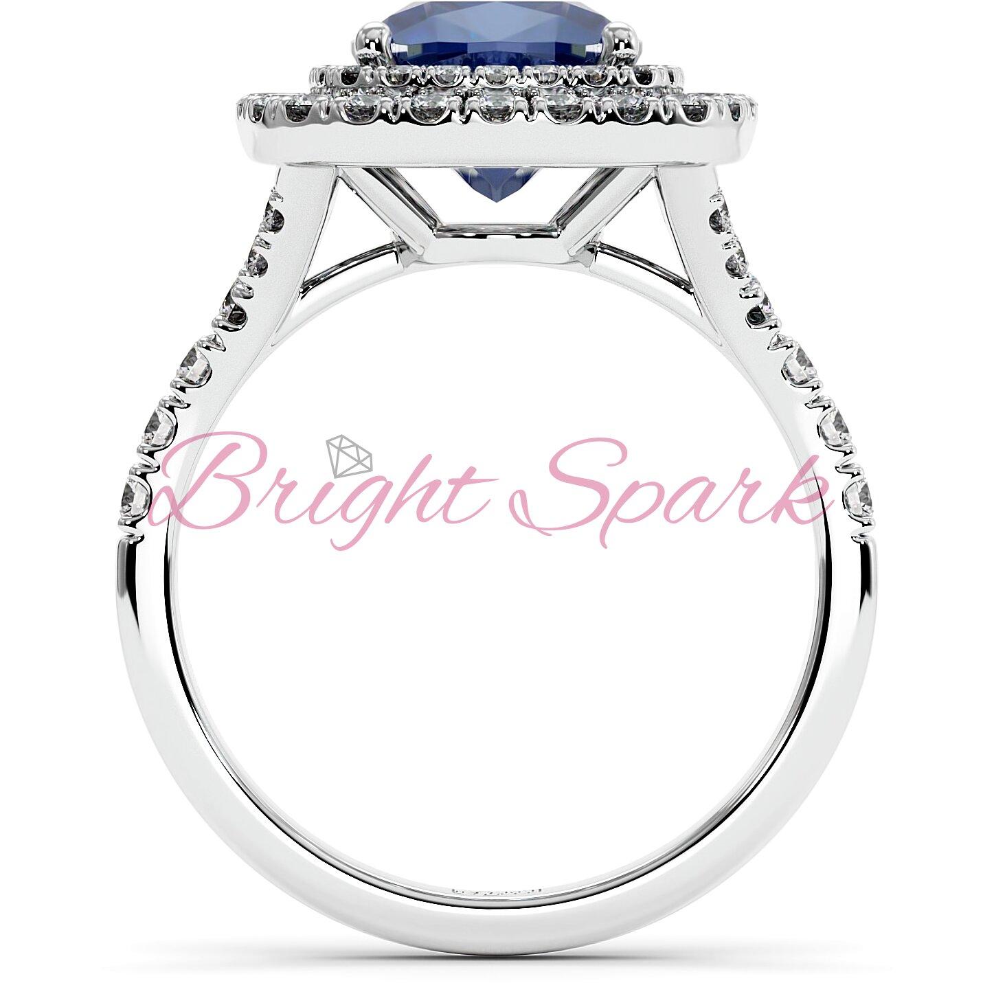 Золотое кольцо с синим сапфиром кушон в ореоле с дорожкой Soul на 2,9 карата