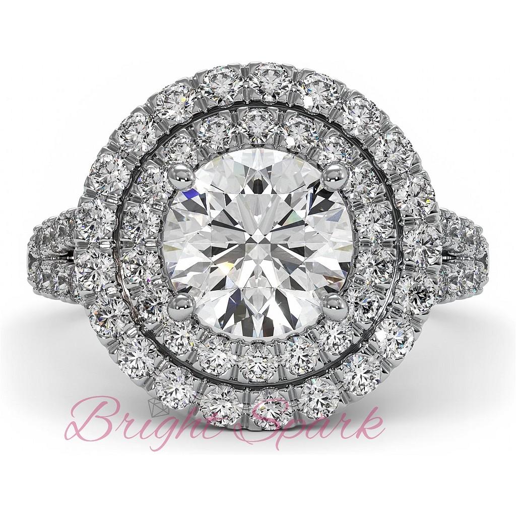 Кольцо с крупным бриллиантом и двумя ореолами
